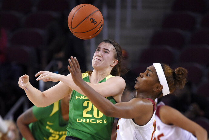 Southern California's Aliyah Mazyck, right, knocks the ball from the hands of Oregon's Sabrina Ionescu during the second half of an NCAA college basketball game Friday, Jan. 11, 2019, in Los Angeles. Oregon won 93-53. (AP Photo/Mark J. Terrill)