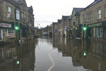 A flooded street in Matlock, northern England, Friday Nov. 8, 2019. Torrential rain drenched parts of north and central England, swelling rivers, forcing evacuations and disrupting travel. One woman died after being swept away by surging waters. (Josh Payne/PA via AP)
