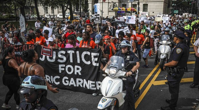 A rally of mostly young people march in protest against the decision by federal prosecutors not to bring civil rights charges against New York City police officer Daniel Pantaleo for the 2014 chokehold death of Eric Garner, Wednesday July 17, 2019, in New York. The protest marks the five-year anniversary of Garner's death. (AP Photo/Bebeto Matthews)