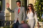 FILE - In this April 9, 2021, file photo Rep. Matt Gaetz, R-Fla., and his girlfriend Ginger Luckey enter 'A Woman for American First' event in Doral, Fla. Before Gaetz rose to national prominence as an ardent backer of Donald Trump, he carved out an unusual reputation in Florida: a Republican lawmaker who wanted to liberalize marijuana laws. (AP Photo/Marta Lavandier, File)