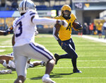 West Virginia running back Leddie Brown (4) rushes the ball against Kansas State during an NCAA college football game Saturday, Oct. 31, 2020, in Morgantown, W.Va. (William Wotring/The Dominion-Post via AP)