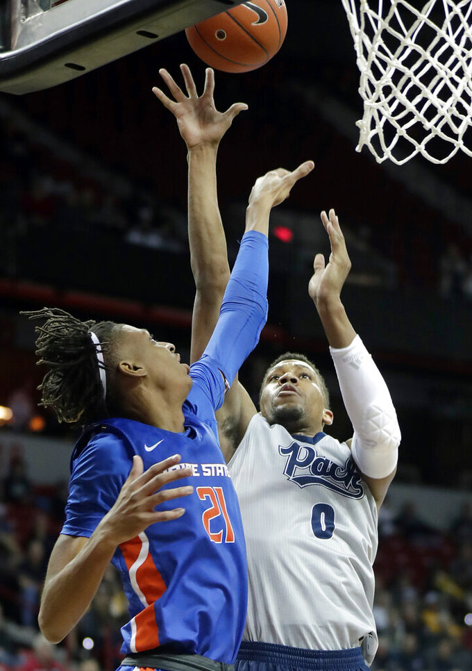 Boise State's Derrick Alston (21) defends as Nevada's Tre'Shawn Thurman shoots during the first half of an NCAA college basketball game in the Mountain West Conference men's tournament Thursday, March 14, 2019, in Las Vegas. (AP Photo/Isaac Brekken)