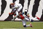 Jacksonville Jaguars wide receiver Marvin Jones Jr., left, is upended by Denver Broncos safety Kareem Jackson after a reception during the first half of an NFL football game, Sunday, Sept. 19, 2021, in Jacksonville, Fla. (AP Photo/Stephen B. Morton)