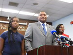 In this Oct. 4, 2019 photo, Marty Small, center, speaks at his swearing-in ceremony as mayor in Atlantic City, N.J. With him are his daughter Jada, left, and his wife La'Quetta, right. On Jan. 9, 2020, Small hailed the rejection of petition signatures seeking a special election on whether to change Atlantic City's government to eliminate a directly elected mayor. (AP Photo/Wayne Parry)