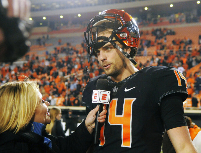 Oklahoma State quarterback Taylor Cornelius speaks with a reporter following an NCAA college football game in Stillwater, Okla., Saturday, Nov. 17, 2018. Oklahoma State defeated West Virginia 45-41. (AP Photo/Brody Schmidt)