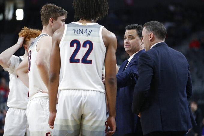 Arizona head coach Sean Miller speaks with his players during the second half of an NCAA college basketball game against Washington in the first round of the Pac-12 men's tournament Wednesday, March 11, 2020, in Las Vegas. (AP Photo/John Locher)