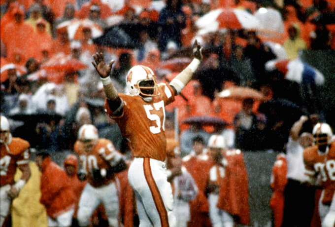 This Dec. 16, 1979, photo shows Tampa Bay Buccaneers linebacker David Lewis celebrating Tampa Bay's 3-0 win over the Kansas City Chiefs, in Tampa, Fla. Lewis, a key member of the Tampa Bay Buccaneers' 1979 team that reached the NFC title game, has died. He was 65. Lewis died Tuesday, July 14, 2020, in Tampa. The cause was not immediately known, but he had struggled with health issues in recent years, according to Southern California, where he played in college. (Tampa Bay Times via AP)