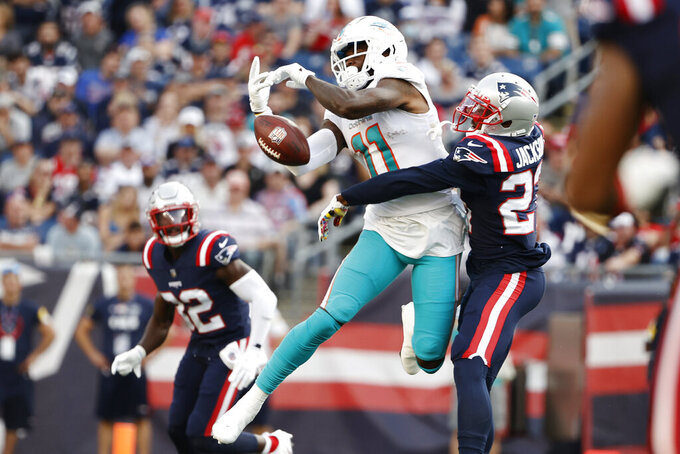 New England Patriots defensive back J.C. Jackson, right, breaks up a pass to Miami Dolphins wide receiver DeVante Parker (11) during the first half of an NFL football game, Sunday, Sept. 12, 2021, in Foxborough, Mass. (AP Photo/Winslow Townson)
