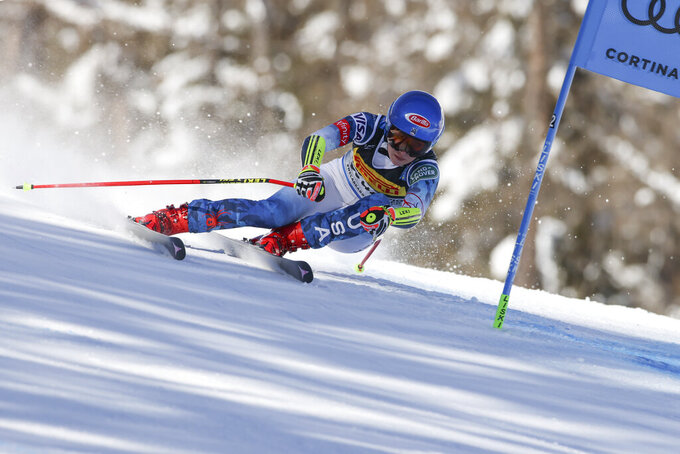 United States' Mikaela Shiffrin speeds down the course during the women's super-G, at the alpine ski World Championships, in Cortina d'Ampezzo, Italy, Thursday, Feb. 11, 2021. (AP Photo/Marco Trovati)