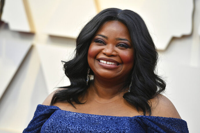 "FILE - In this Feb. 24, 2019 file photo, Octavia Spencer arrives at the Oscars  at the Dolby Theatre in Los Angeles. The Producers Guild of America will honor Octavia Spencer for her work behind-the-camera at its 2020 awards show. Spencer, who was among the producers of last year's best picture Oscar winner ""Green Book,"" will receive the Visionary Award at the Producers Guild Awards on Jan. 18.(Photo by Jordan Strauss/Invision/AP, File)"