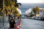 A pilgrim crawls from the port to the Holy Church of Panagia of Tinos, on the Aegean island of Tinos, Greece, on Thursday, Aug. 13, 2020. For nearly 200 years, Greek Orthodox faithful have flocked to Tinos for the August 15 feast day of the Assumption of the Virgin Mary, the most revered religious holiday in the Orthodox calendar after Easter. But this year there was no procession, the ceremony _ like so many lives across the globe _ upended by the coronavirus pandemic. (AP Photo/Thanassis Stavrakis)