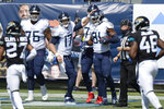 Tennessee Titans quarterback Ryan Tannehill (17) congratulates tight end Jonnu Smith (81) after the two teamed up for a 13-yard touchdown pass against the Jacksonville Jaguars in the first half of an NFL football game Sunday, Sept. 20, 2020, in Nashville, Tenn. (AP Photo/Mark Zaleski)