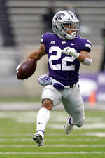 Kansas State running back Deuce Vaughn (22) runs for a first down during the first half of an NCAA football game against Kansas Saturday, Oct. 24, 2020, in Manhattan, Kan. (AP Photo/Charlie Riedel)