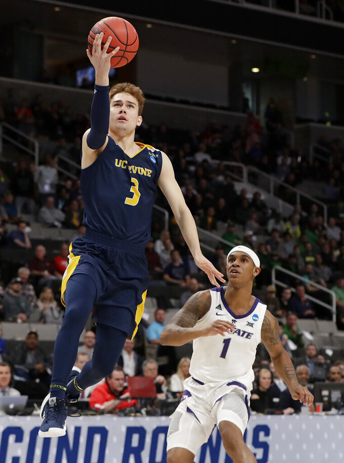 UC Irvine guard Robert Cartwright (3) shoots past Kansas State guard Shaun Neal-Williams (1) during the second half of a first-round game in the NCAA men's college basketball tournament Friday, March 22, 2019, in San Jose, Calif. (AP Photo/Chris Carlson)