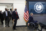 Texas Gov. Greg Abbott, right, is followed by Vice President Mike Pence, Housing and Urban Development Secretary Ben Carson and Dr. John Hellerstedt, left, Commissioner of the Texas Department of State Health Services as they arrive for a news conference after Pence met with Abbott and members of his health care team regarding COVID-19 at the University of Texas Southwestern Medical Center West Campus in Dallas, Sunday, June 28, 2020. (AP Photo/Tony Gutierrez)