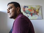In this Jan. 6, 2020, photo, Michael Navas Gomez, a political activist from Nicaragua, poses for a photo at his attorney's office in Los Angeles. Navas Gomez, who was detained in a remote detention facility in Louisiana for five months, was granted asylum in the U.S. (AP Photo/Damian Dovarganes)