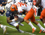 Illinois linebacker Jake Hansen (35) sacks Connecticut quarterback Jack Zergiotis (11) during the first half of an NCAA college football game, Saturday, Sept. 7, 2019, in East Hartford, Conn. (AP Photo/Jessica Hill)