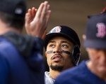 Boson Red Sox's Mookie Betts is congratulated by teammates after scoring against the Minnesota Twins in the first inning of a baseball game Monday, June 17, 2019, in Minneapolis. (AP Photo/Andy Clayton- King)
