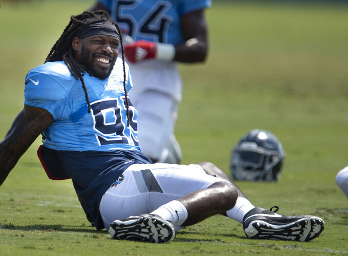 Tennessee Titans outside linebacker Jadeveon Clowney (99) warms up during an NFL football practice in Nashville, Wednesday, Sept. 9, 2020. (George Walker IV/The Tennessean via AP, Pool)