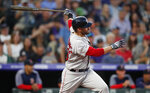 Boston Red Sox's J.D. Martinez follows the flight of his two-run home run off Colorado Rockies starting pitcher Peter Lambert in the top of the third inning of a baseball game Wednesday, Aug. 28, 2019, in Denver. (AP Photo/David Zalubowski)