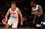 Canada's Kevin Pangos, left, drives past the United States' Kemba Walker during their exhibition basketball game in Sydney, Australia, Monday, Aug. 26, 2019. (AP Photo/Rick Rycroft)