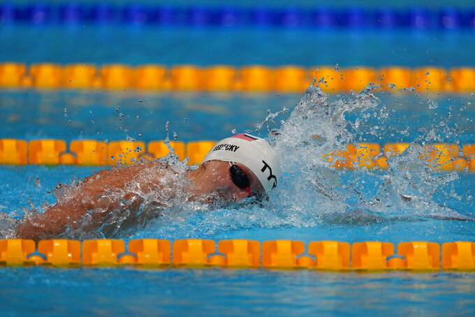 Katie Ledecky, of the United States, swims in a heat during the women's 400-meter freestyle at the 2020 Summer Olympics, Sunday, July 25, 2021, in Tokyo, Japan. (AP Photo/Matthias Schrader)