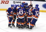 New York Islanders players celebrate their overtime victory over the Detroit Red Wings in a preseason NHL hockey game Monday, Sept. 23, 2019, in Uniondale, N.Y. (AP Photo/Kathleen Malone-Van Dyke)