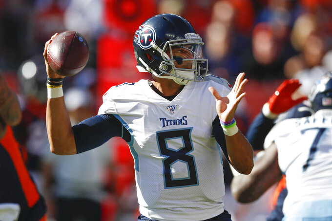 Tennessee Titans quarterback Marcus Mariota looks to throw a pass during the first half of an NFL football game against the Denver Broncos, Sunday, Oct. 13, 2019, in Denver. (AP Photo/David Zalubowski)