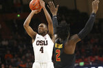 Oregon State's Alfred Hollins shoots next to Southern California's Jonah Mathews during the first half of an NCAA college basketball game in Corvallis, Ore., Thursday, Jan. 10, 2019. (AP Photo/Amanda Loman)