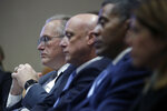Pacific Gas and Electric Company (PG&E) CEO Bill Johnson, from left, sits with President and CEO Andy Vesey and Senior Vice President, Electric Operations Michael Lewis during a California Public Utilities Commission meeting in San Francisco, Friday, Oct. 18, 2019. (AP Photo/Jeff Chiu)