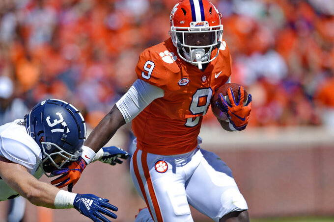 Clemson's Travis Etienne breaks away from Georgia Southern's Lane Ecton during the first half of an NCAA college football game Saturday, Sept. 15, 2018, in Clemson, S.C. (AP Photo/Richard Shiro)