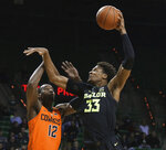 Baylor forward Freddie Gillespie, right, scores over Oklahoma State forward Cameron McGriff during the second half of an NCAA college basketball game Wednesday, March 6, 2019, in Waco, Texas. (Rod Aydelotte/Waco Tribune Herald via AP)
