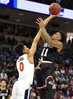 Gardner-Webb's David Efianayi (11) shoots over Virginia's Kihei Clark (0) during a first-round game in the NCAA men's college basketball tournament in Columbia, S.C., Friday, March 22, 2019. (AP Photo/Richard Shiro)