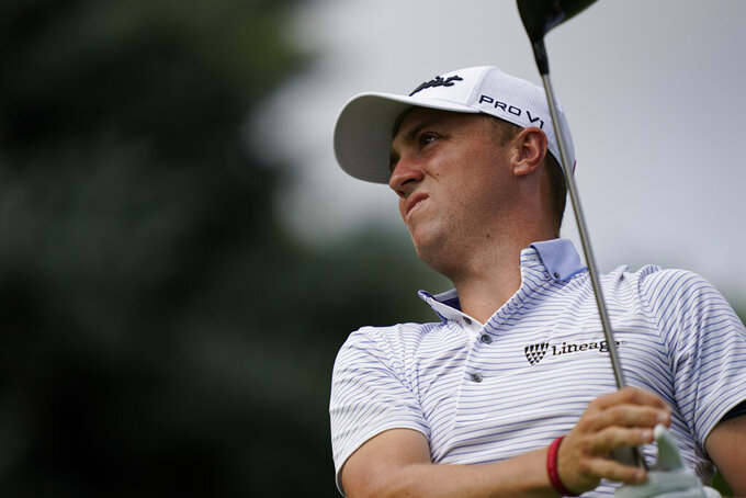 Justin Thomas watches his shot off the ninth tee in the first round of play at the Northern Trust golf tournament, Thursday, Aug. 19, 2021, at Liberty National Golf Course in Jersey City, N.J. (AP Photo/John Minchillo)