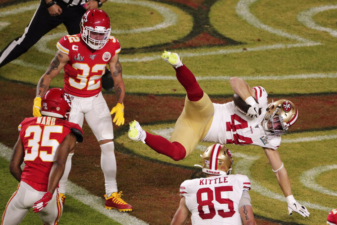 San Francisco 49ers' Kyle Juszczyk (44) scores a touchdown, during the first half of the NFL Super Bowl 54 football game against the Kansas City Chiefs', Sunday, Feb. 2, 2020, in Miami Gardens, Fla. (AP Photo/Charlie Riedel)