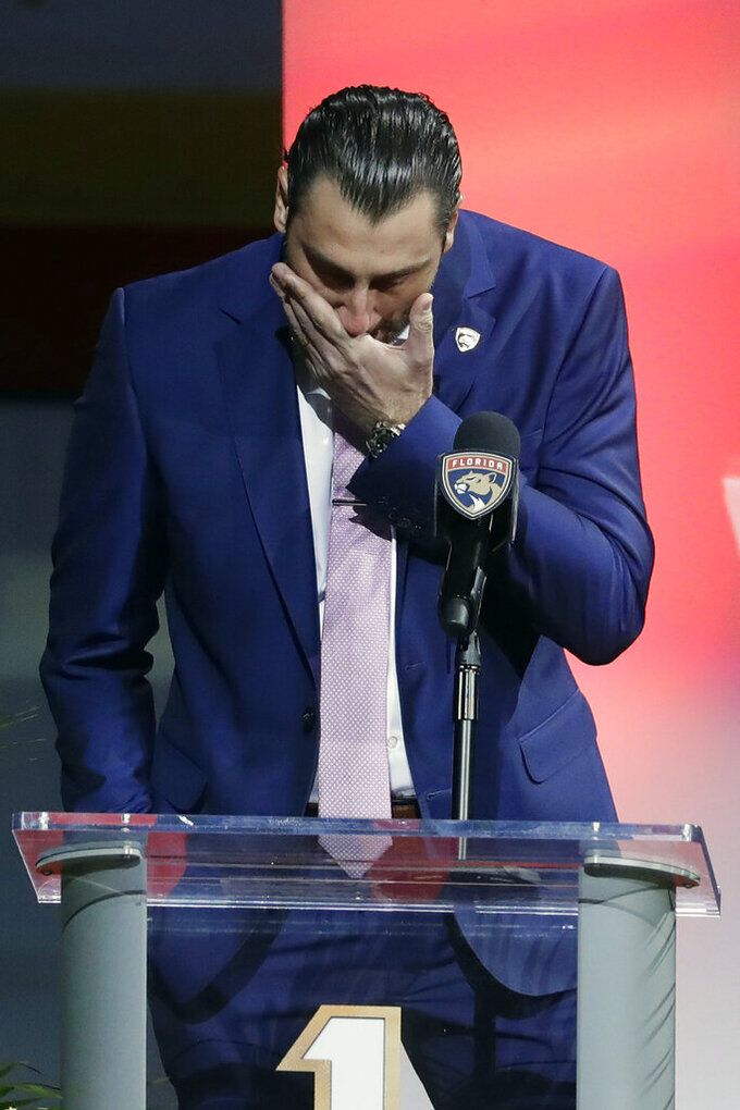 Former Florida Panthers goalie Roberto Luongo pauses as he speaks to fans about his family, before his jersey is hoisted to the rafters during a ceremony before an NHL hockey game against the Montreal Canadiens, Saturday, March 7, 2020, in Sunrise, Fla. (AP Photo/Wilfredo Lee)