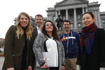 In this Tuesday, Jan. 21, 2020, photograph, from left, Stephanie Cain, Matthew McAllister, Janell Schafer, Kelly Taylor and Yeri Kim, all members of the Colorado Digital Service, are shown outside the State Capitol in downtown Denver. (AP Photo/David Zalubowski)