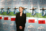 FILE - This Nov. 10, 2005 file photo shows actress Julie Andrews posing in front of posters for the 40th anniversary special edition DVD release party of the