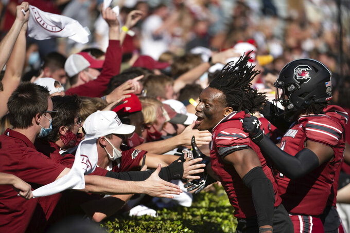 South Carolina defensive back Jaycee Horn (1) celebrates with students after defeating Auburn during an NCAA college football game Saturday, Oct. 17, 2020, in Columbia, S.C. South Carolina defeated Auburn 30-22. (AP Photo/Sean Rayford)