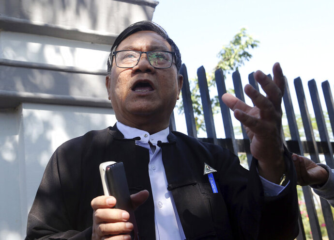 Khin Maung Zaw, a lawyer of two Reuters journalists, Wa Lone and Kyaw Soe Oo, talks to journalists as he leaves the Supreme Court after submitting appeal documents of the two journalists in Naypyitaw, Myanmar, Friday, Feb. 1, 2019. Lawyers for the two journalists sentenced to seven years in jail on charges of breaking the Official Secrets Act filed an appeal to the country's supreme court, after a high court judge rejected their appeal in January. (AP Photo/Aung Shine Oo)