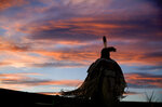 FILE - In this July 13, 2018, file photo, a woman performs a traditional Native American dance during the North American Indian Days celebration on the Blackfeet Indian Reservation in Browning, Mont. Friday, April 26, 2019 marks the beginning of a two-day powwow in New Mexico that represents one of the largest annual gatherings of indigenous people in the United States. Organizers say they want to build awareness this year around the deaths and disappearances of Native American women. (AP Photo/David Goldman, file)