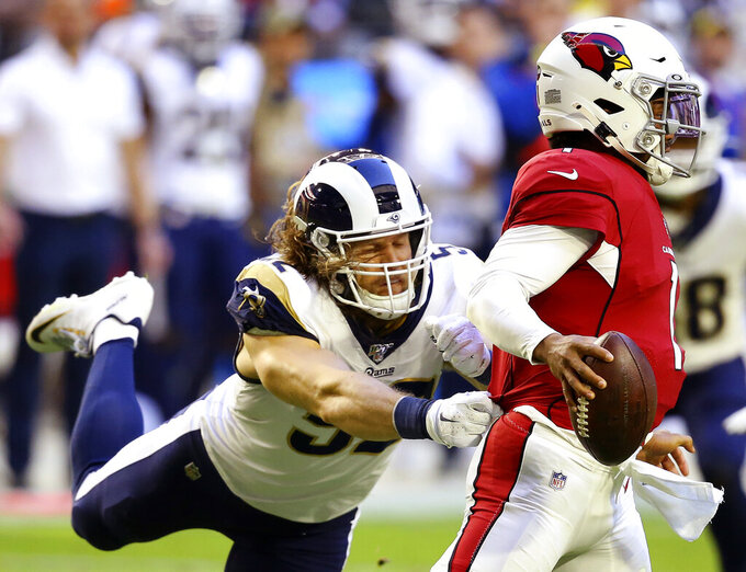 FILE - In this Dec. 1, 2019, file photo, Arizona Cardinals quarterback Kyler Murray (1) is pressured by Los Angeles Rams outside linebacker Clay Matthews during the first half of an NFL football game in Glendale, Ariz. Matthews is still unsigned as Week 1 of the NFL season begins. (AP Photo/Ross D. Franklin, File)