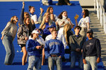 FILE  - In this Oct. 3, 2020, file photo, Kentucky fans cheer during the second half of an NCAA college football game against Mississippi, in Lexington, Ky. Coaches wearing masks around their chins. Fans not wearing masks at all while cheering from their seats. One school deciding to drop the safety checks it was requiring for those entering the stadium to cut down on long lines. College football is sending plenty of alarming signals at it attempts to get through a tenuous season amid a pandemic. (AP Photo/Bryan Woolston, File)