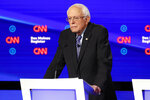 Democratic presidential candidate Sen. Bernie Sanders, I-Vt., listens Tuesday, Jan. 14, 2020, during a Democratic presidential primary debate hosted by CNN and the Des Moines Register in Des Moines, Iowa. (AP Photo/Patrick Semansky)