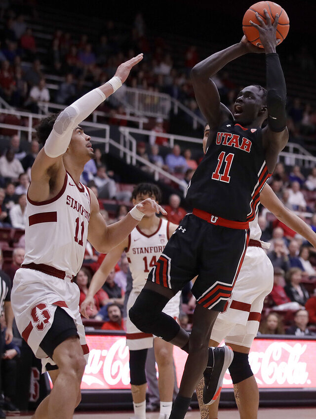 Utah's Both Gach, right, shoots against Stanford's Jaiden Delaire in the second half of an NCAA college basketball game Wednesday, Feb. 26, 2020, in Stanford, Calif. (AP Photo/Ben Margot)