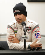 In this Friday, Jan. 5, 2018 photo, Penske team driver Helio Castroneves, of Brazil, makes comments at a news conference during testing for the IMSA 24 hour auto race at Daytona International Speedway in Daytona Beach, Fla. (AP Photo/John Raoux)