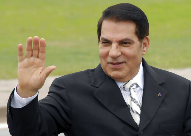FILE - In this Oct.11, 2009 file photo, then Tunisian President Zine El Abidine Ben Ali waves from his car at a campaign rally in Rades, outside Tunis.  Swiss authorities said Monday Jan. 18, 2021, they are preparing to lift a freeze on tens of millions of dollars' worth of assets linked to former Tunisian President Zine El Abidine Ben Ali, who fled with his family to Saudi Arabia in 2011 and died in 2019. (AP Photo/Hassene Dridi, File)