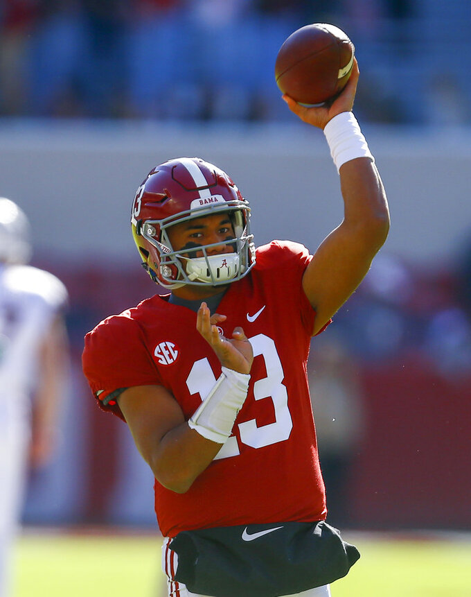 Alabama quarterback Tua Tagovailoa (13) warms up before an NCAA college football game against Mississippi State, Saturday, Nov. 10, 2018, in Tuscaloosa, Ala. (AP Photo/Butch Dill)