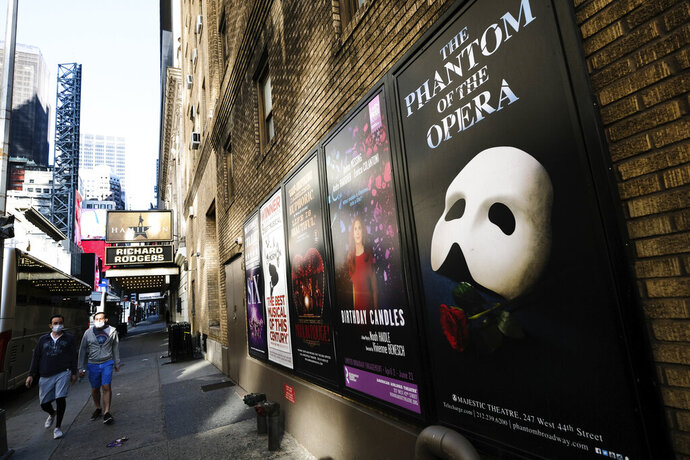 "FILE - Broadway posters outside the Richard Rodgers Theatre in New York on May 13, 2020.  Broadway theaters may be dark but there will be plenty of new online productions of some of classic plays this fall. ""Hamilton"" producer Jeffrey Richards on Wednesday unveiled a seven weekly play run of livestreamed works to benefit The Actors Fund. They will stream on Broadway's Best Shows and ticket buyers can access the events through TodayTix starting at $5. The plays include ""The Best Man,"" ""This Is Our Youth,"" Time Stands Still"" and ""Race"" (Photo by Evan Agostini/Invision/AP, File)"