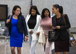 CORRECTS THE DESCRIPTION OF THE TWO WOMEN AS HAVING LIVED WITH R. KELLY RATHER THAN GIRLFRIENDS - Joycelyn Savage, second from left, and Azriel Clary, second from right, women who lived with R&B singer R. Kelly, walk into Dirksen Federal Courthouse for Kelly's hearing with attorney Gloria Schmidt, left, another attorney, Tuesday afternoon, July 16, 2019. Kelly is expected to appear on charges that he recruited girls and women to have illegal sex with him and then covered up the crimes by paying and threatening the victims and witnesses. (Ashlee Rezin/Sun-Times/Chicago Sun-Times via AP)